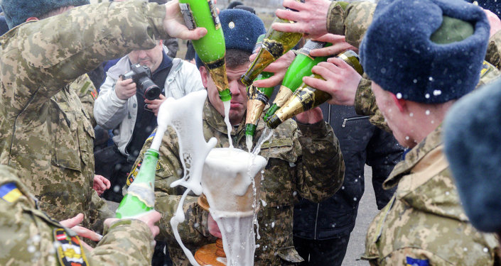 Former cadets of the military faculty of National Technical University pour champagne in northeastern Ukrainian city of Kharkiv