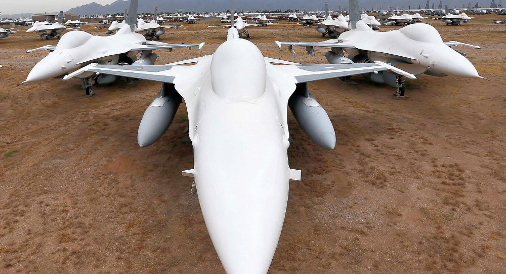 F-16 Fighting Falcons sit in a field along Miami St. at the 309th Aerospace Maintenance and Regeneration Group boneyard at Davis-Monthan Air Force Base in Tucson, Ariz