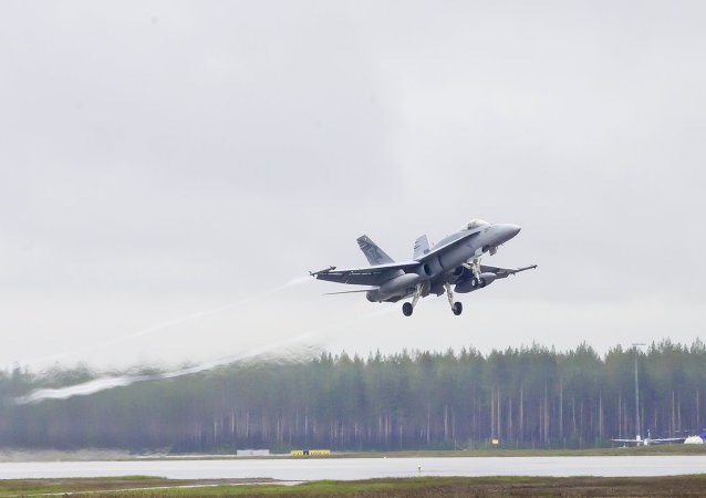 A swiss F/A-18 Hornet takes off from Kallax Airport outside Lulea, northern Sweden, May 26, 2015, during the Arctic Challenge Exercise (ACE 2015)