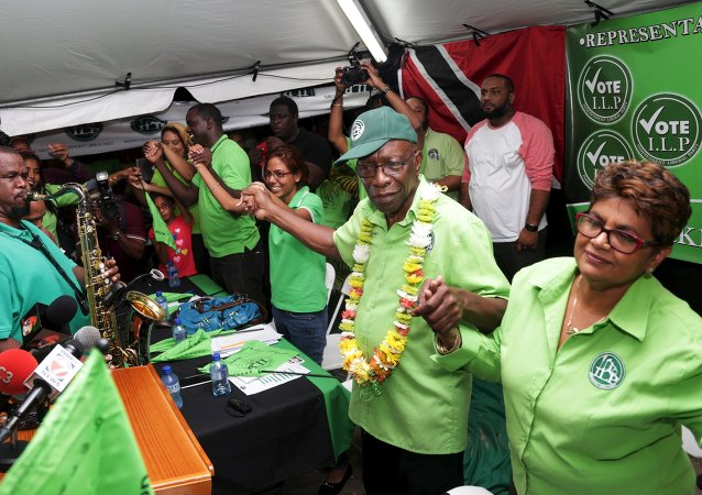 Former FIFA Vice President Jack Warner (2nd R) holds hands with supporters during a political rally organised by his Independent Liberal Party in Chaguanas, in Trinidad and Tobago, May 28, 2015