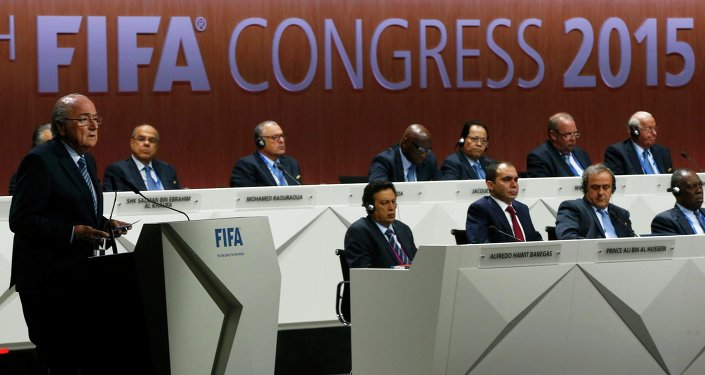 FIFA President Sepp Blatter (L) delivers an opening speech at the 65th FIFA Congress in Zurich, Switzerland