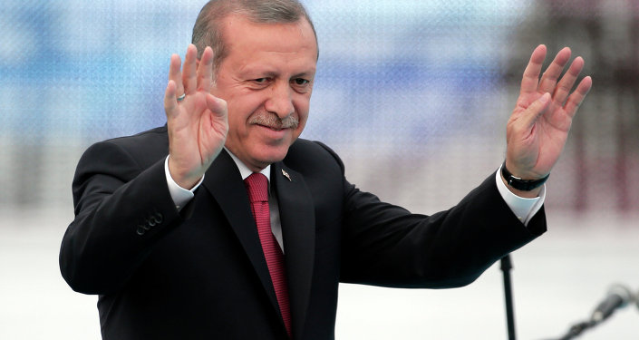 Turkey's President Recep Tayyip Erdogan waves to people gathered during a rally to commemorate the anniversary of the city's conquest by the Ottoman Turks, Istanbul, Turkey