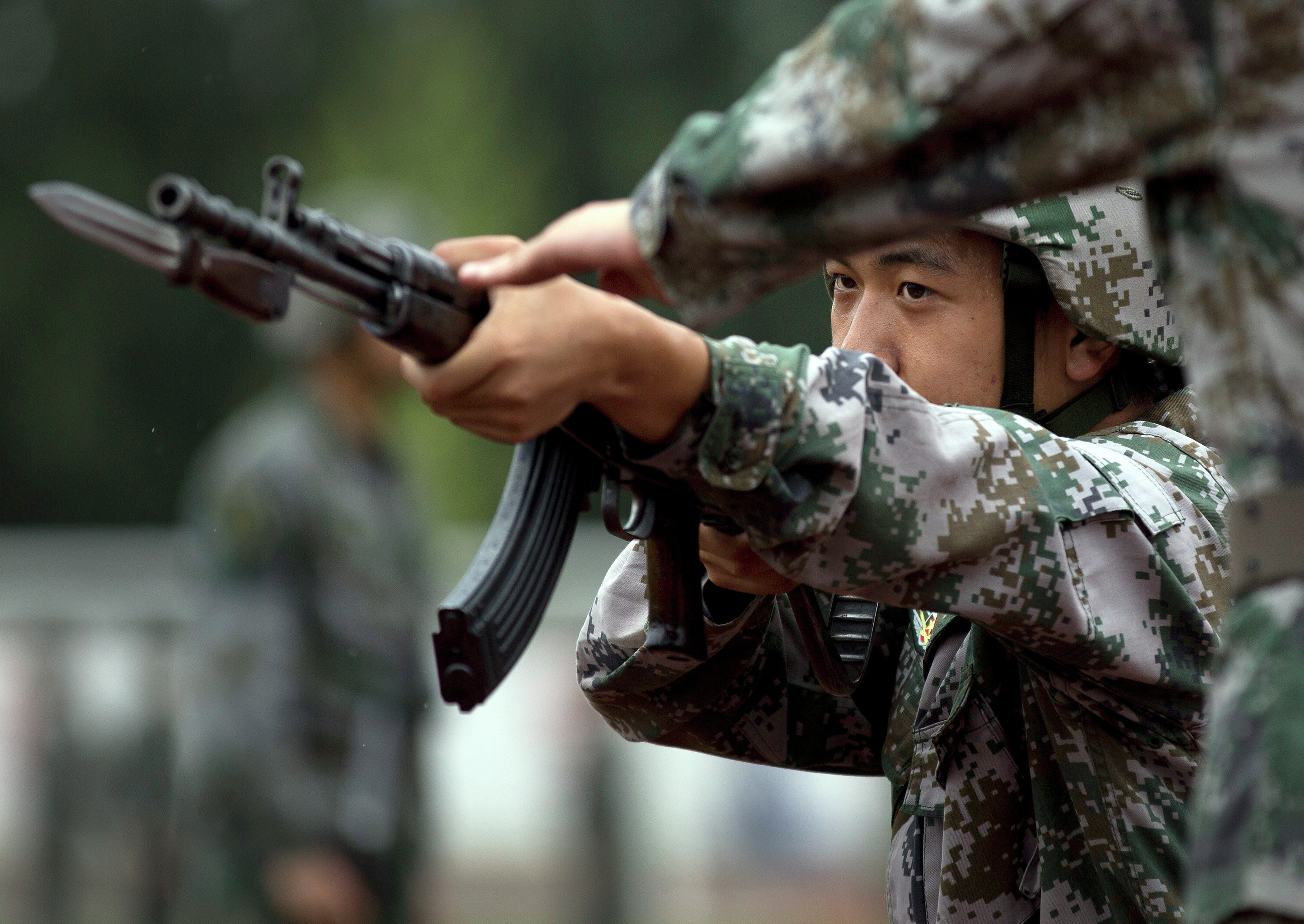 Chinese People's Liberation Army cadets take part in a bayonet drills at the PLA's Armoured Forces Engineering Academy Base