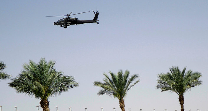 An Egyptian army helicopter patrols the venue of a meeting of Arab heads of state, in Sharm el Sheik, South Sinai, Egypt, Saturday, March 28, 2015