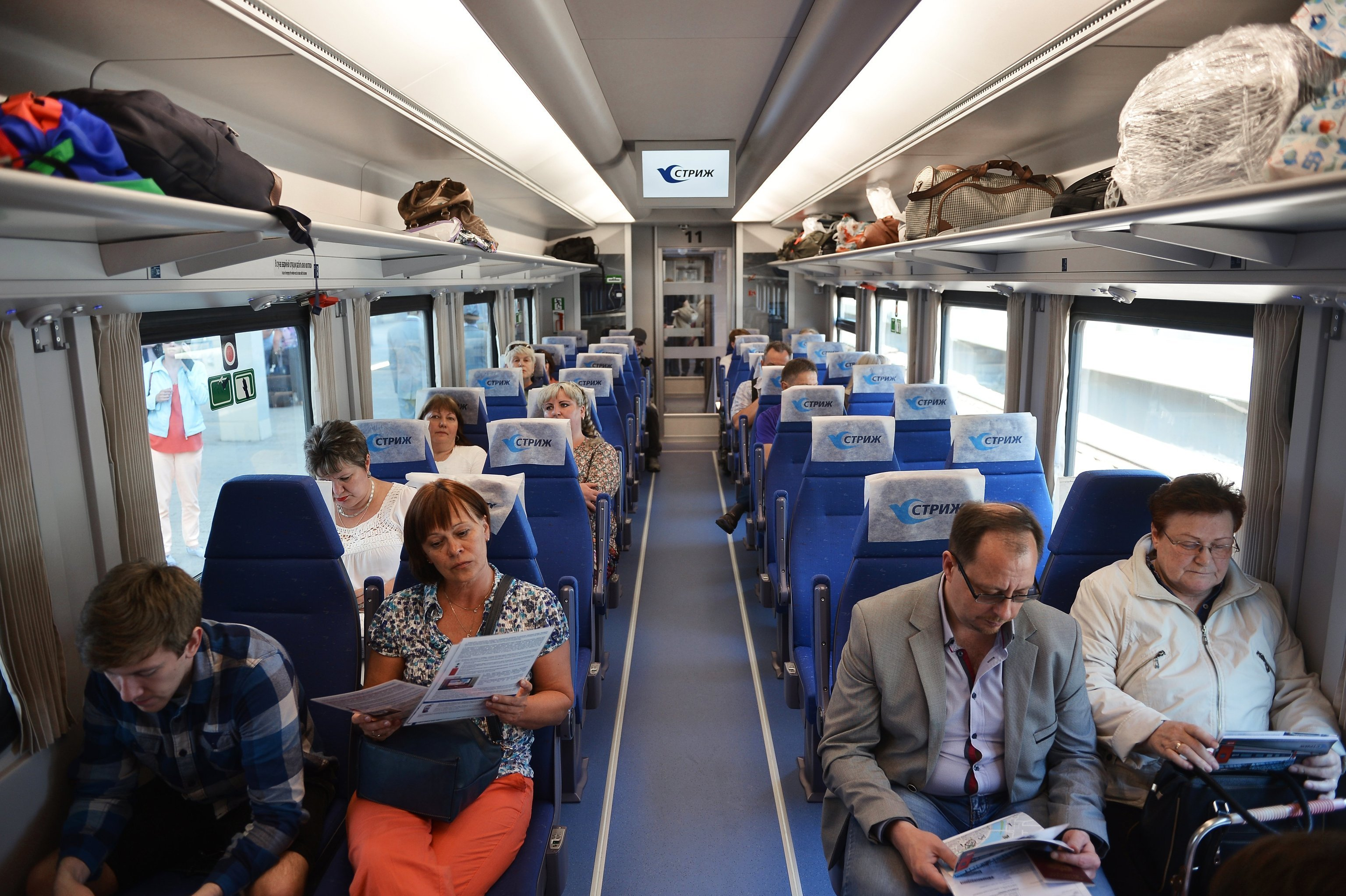 All Aboard! Passengers take their seats aboard the Strizh high speed train.