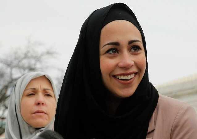 Muslim woman Samantha Elauf (R), who was denied a sales job at an Abercrombie Kids store in Tulsa in 2008, stands with her mother Majda outside the US Supreme Court in Washington