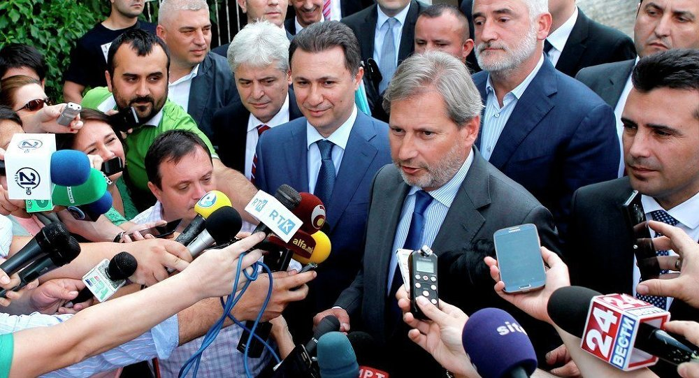 EU commissioner for Neighborhood Policy & Enlargement Negotiations Johannes Hahn, second from right, talks for the media