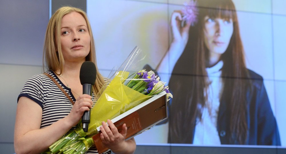 Winner of the Andrei Stenin International Press Photo Contest's Grand Prix Yelena Anosova at the award ceremony held at the Rossiya Segodnya International News Agency's International Multimedia Press Center