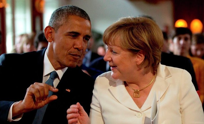 German Chancellor Angela Merkel, right, speaks with US President Barack Obama during the G-7 summit