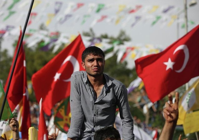 Backdropped by Turkish flags a supporter of Kurdish People's Democratic Party (DHP) attends a rally in Diyarbakir, southeastern Turkey.