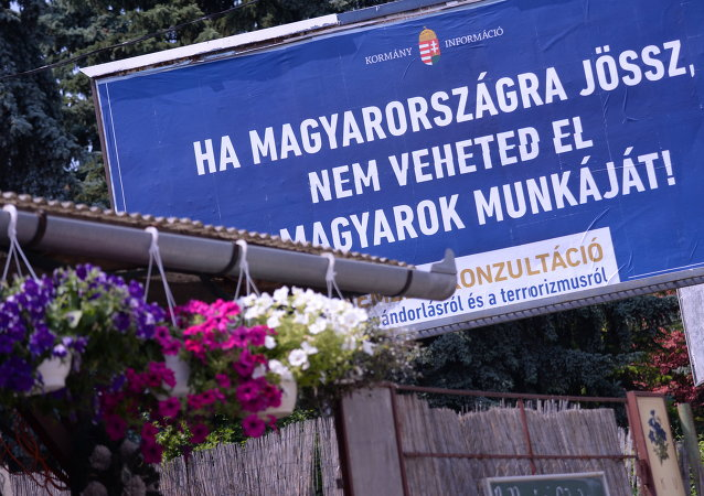 A billboard with a state-funded anti-immigration poster reads in Hungarian 'If you come to Hungary, do not take the Hungarians' jobs !' at the third district of Budapest on June 8, 2015