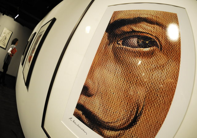 A woman walks past works by Spanish artist Salvador Dali. file photo