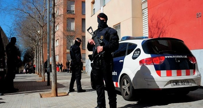 Mossos d'Esquadra regional police officers stand guard during a raid in one of the region's biggest operations against jihad activity in Sabadell, near Barcelona, Spain