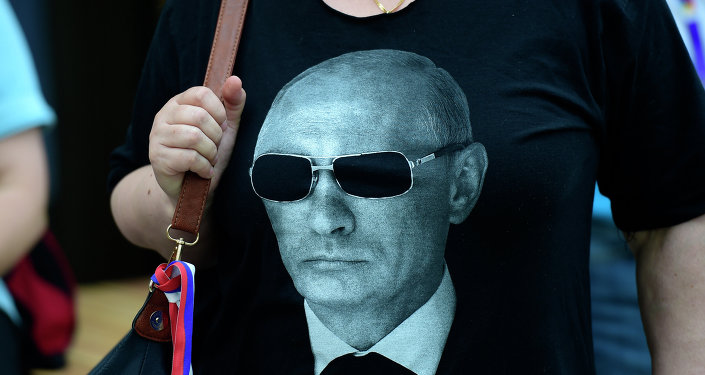 A woman wears a tee-shirt showing a portrait of Russian President Vladimir Putin before his arrival at the Expo Milano 2015, the universal exhibition
