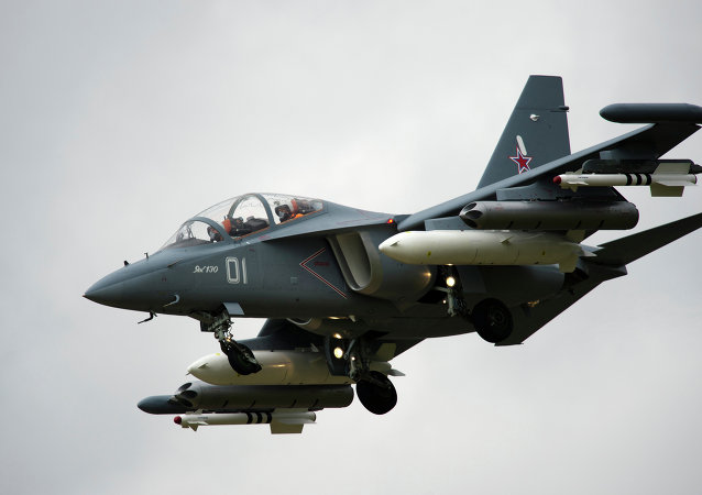 A Yak 130 takes part in a flying display at the Farnborough International Airshow in Hampshire, southern England, on July 9, 2012.