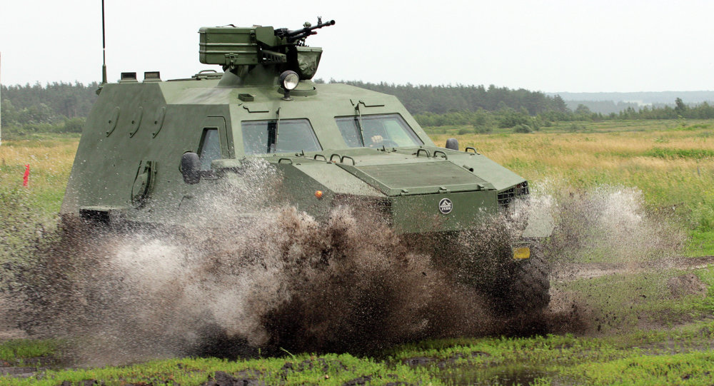 A new Dozor-B Ukrainian army armoured personnel carrier is driven by soldiers on the training ground in Chuguyev, Kharkiv region.