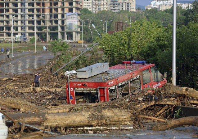 A fire-engine is seen among debris at a flooded street in Tbilisi, Georgia, June 14, 2015