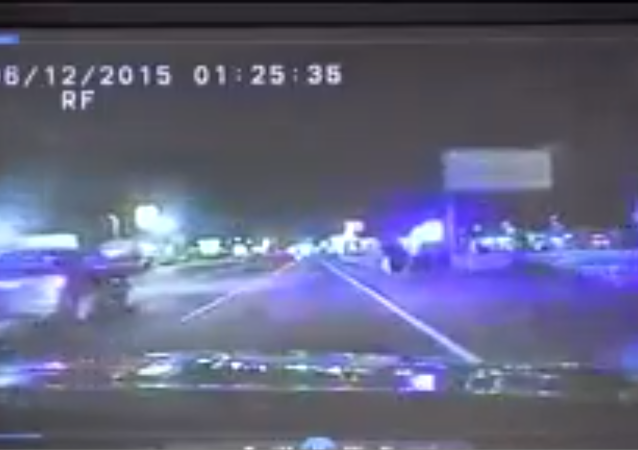 Screenshot from a police dashcam during a high-speed chase of a motorycle