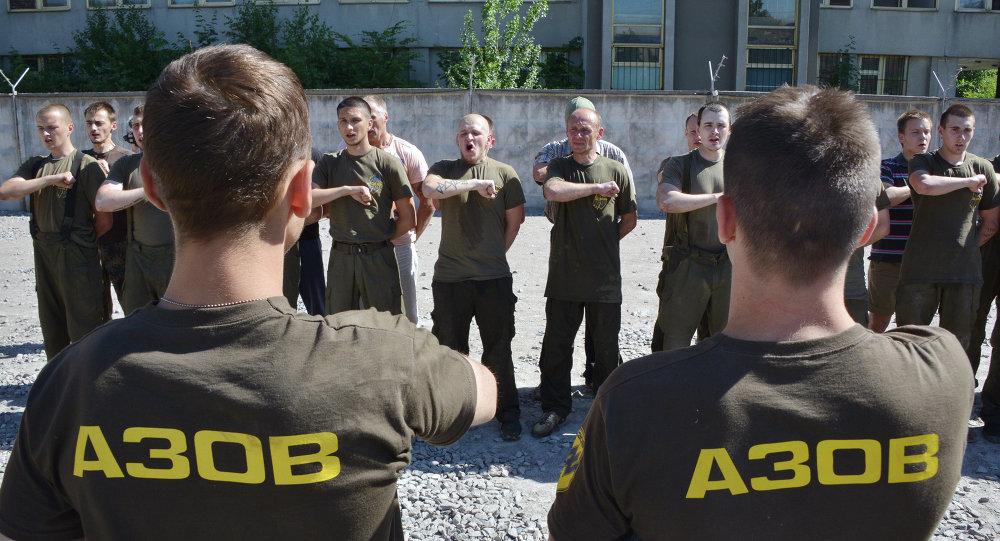 Recruits of the Ukrainian Azov regiment line-up after their final tests at a base in Kiev
