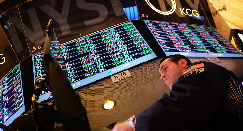 A trader works on the floor of the New York Stock Exchange (NYSE) on February 6, 2015, in New York