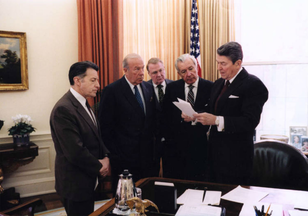 President Ronald Reagan goes over his remarks on the Iran-Contra Affair in the Oval Office.