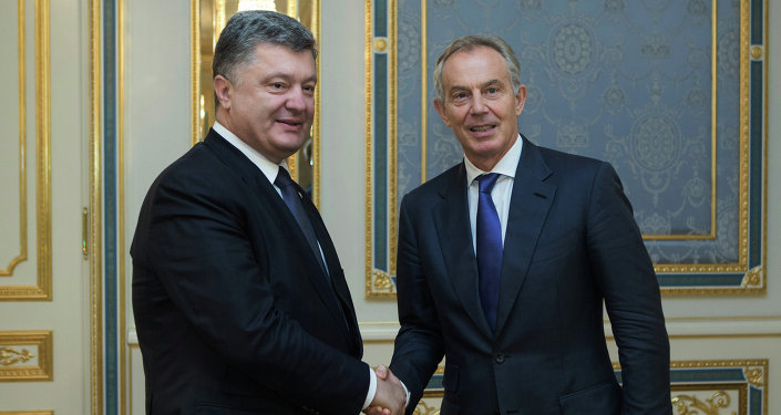 Ukrainian President Petro Poroshenko , left, and former British Prime Minister Tony Blair shake hands during their meeting in Kiev, Ukraine, Wednesday, June 17, 2015