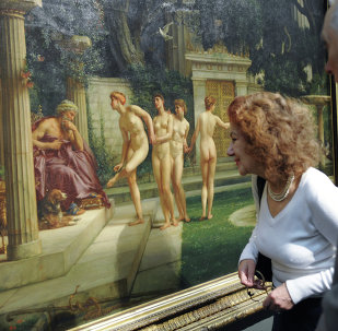 Visitors of the exhibition Images of History in the European Art of the 19th Century looking at Edward Poynter's Visit to the Aesculipius