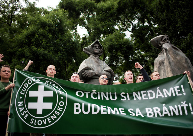 Participants hold a banner reading We will defend our fatherland during an anti-immigration rally organised by an initiative called Stop Islamisation of Europe and backed by the far-right People's Party-Our Slovakia on June 20, 2015 in Bratislava, Slovakia