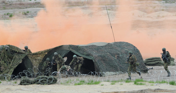 Soldiers take part in the NATO Noble Jump exercise on a training range near Swietoszow Zagan, Poland, Thursday, June 18, 2015