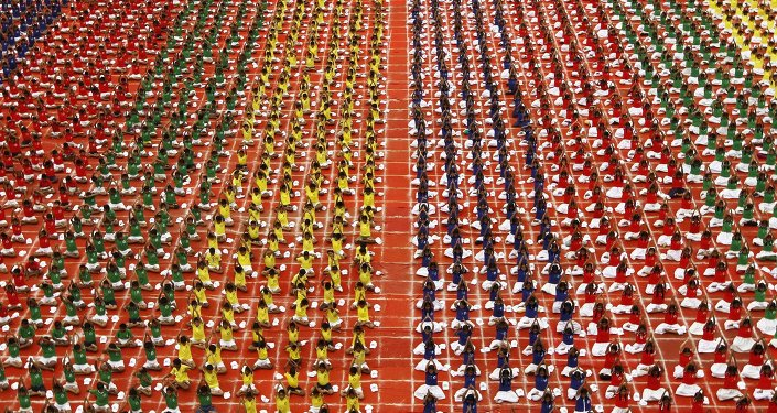 Students practice yoga in the lawns of their school ahead of International Day of Yoga, in Chennai, India, June 19, 2015