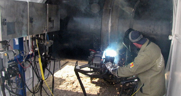 Turkmen worker welds togther the first segments of the gas trunk pipeline