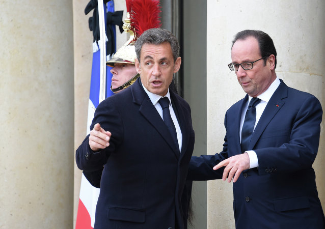 "French President Francois Hollande (R) welcomes France's former President and leader of the right-wing UMP party Nicolas Sarkozy (L) at the Elysee Palace before attending a Unity rally ""Marche Republicaine"" on January 11, 2015"