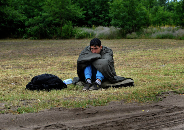 An Afghan refugee rests on the Hungarian Serbian border area near Asotthalom, Hungary.