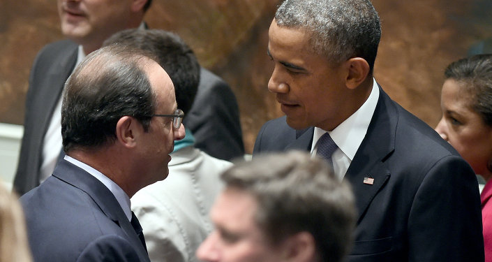 US President Barack Obama speaks with French President Francois Hollande at special meeting of the UN security council during the 69th Session of the UN General Assembly on September 24, 2014 in New York