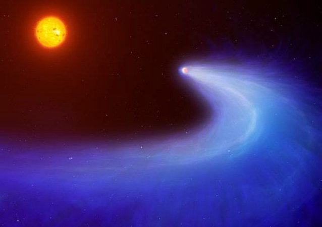This artist's impression shows exoplanet GJ 436b, which is surrounded by a massive gas cloud that streams behind the planet like a comet's tail for millions of miles