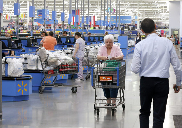 Shoppers walk through the lobby of a Wal-Mart Supercenter store in Springdale, Ark., Thursday, June 4, 2015