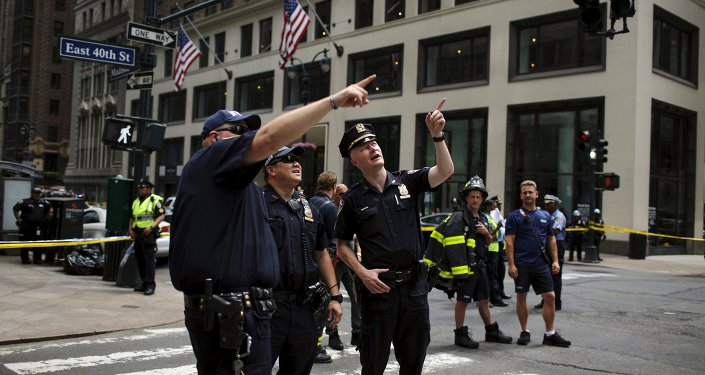 New York Police Department officers attend an emergency response after the cable of the crane snapped on a building in Manhattan, New York May 31, 2015