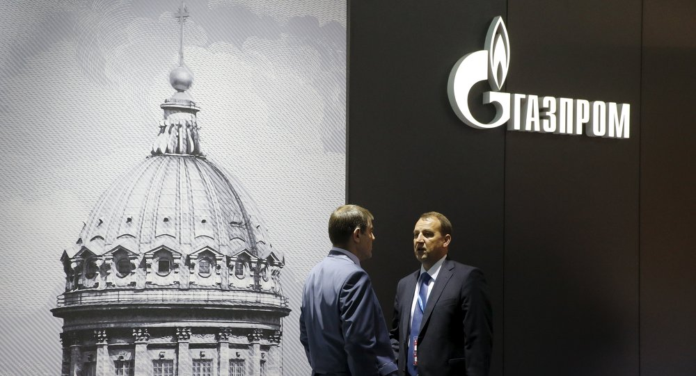 Men speak near the pavilion of Gazprom company at the St. Petersburg International Economic Forum 2015 (SPIEF 2015) in St. Petersburg, Russia, June 18, 2015