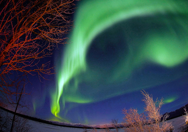 Aurora: a Sun-Kissed Earth Spectacle