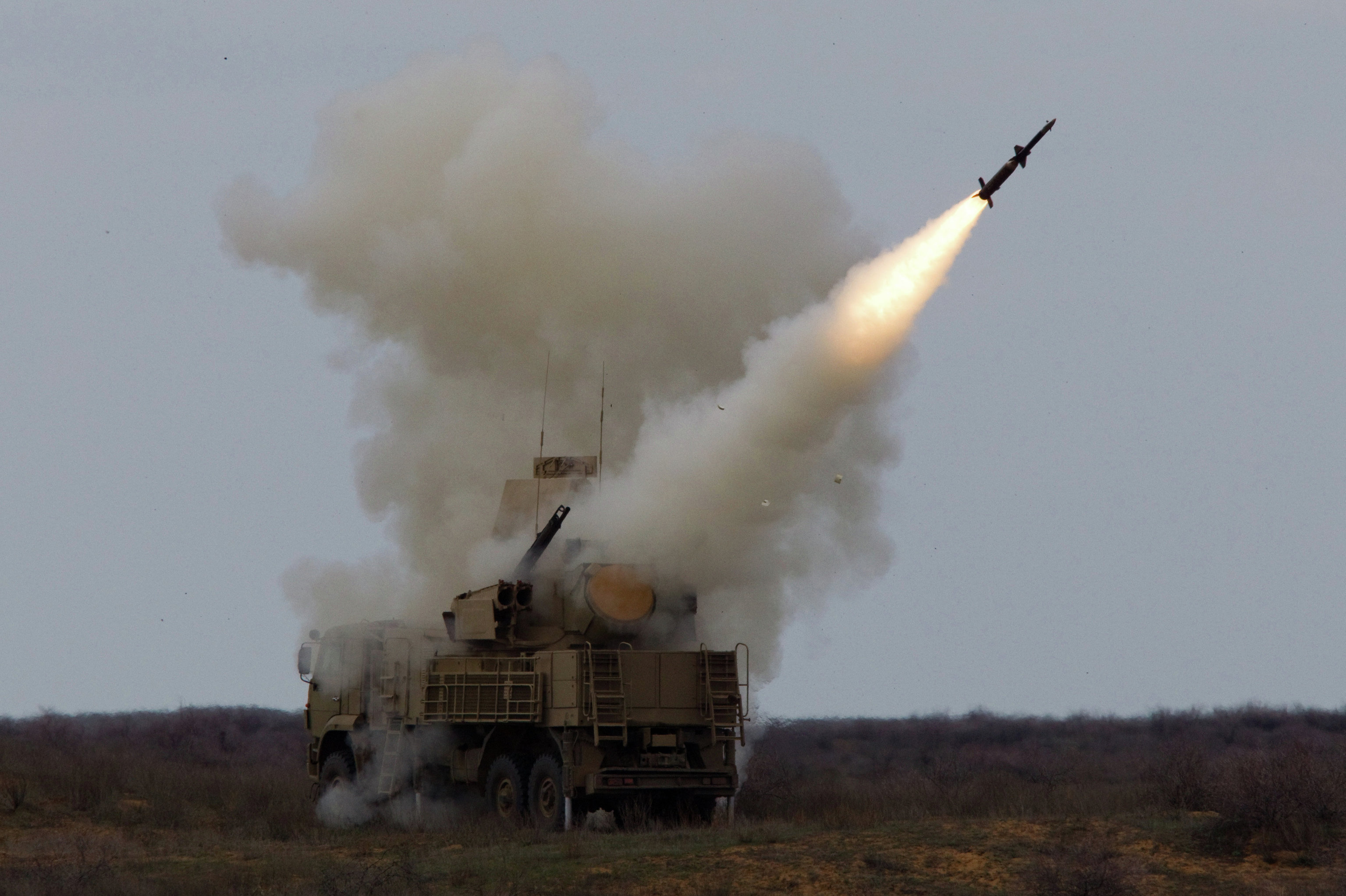 Pantsir-S1 launching missile during drills