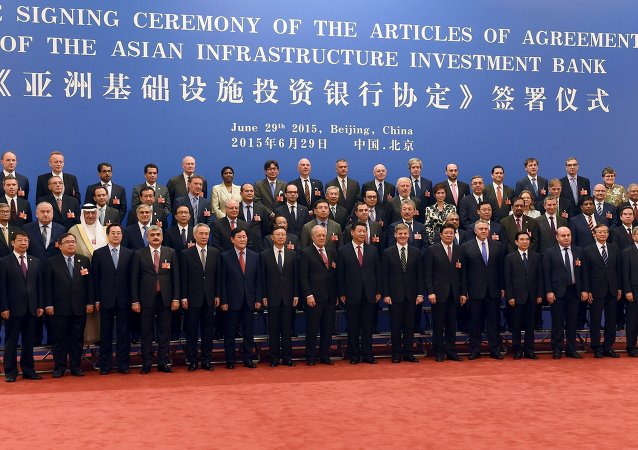 Chinese President Xi Jinping (C, front) poses for a group photo with the delegates attending the signing ceremony for the Articles of Agreement of the Asian Infrastructure Investment Bank (AIIB) at the Great Hall of the People in Beijing June 29, 2015