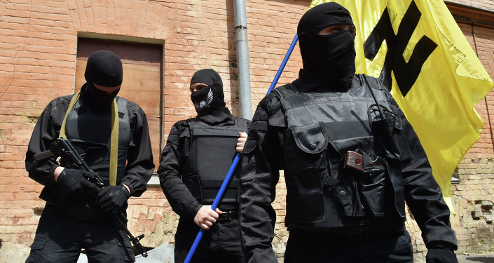 Fighters of Social Nationalist Assembly (SNA), part of the ultra-nationalist Right Sector party, attend a swearing-in ceremony in Kiev prior to leaving on June 3, 2014