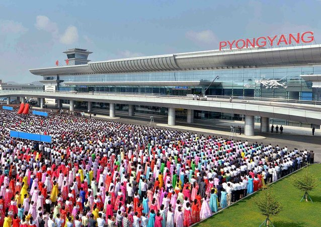 People attend the opening ceremony for the newly built terminal of Pyongyang International Airport in this undated picture released by North Korea's Korean Central News Agency (KCNA) on July 1, 2015