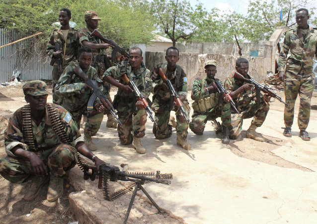 Somali government soldiers pose after they captured Belidogle airport, Somalia, with some help from African Union troops, in 2012.