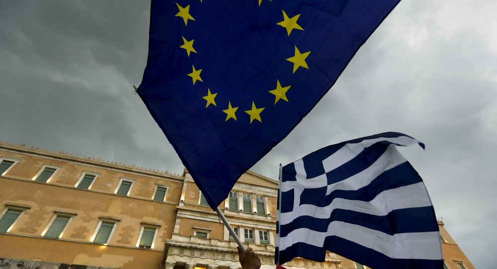 Protesters wave Greek and EU flags during a pro-Euro rally in front of the parliament building, in Athens, Greece, June 30, 2015