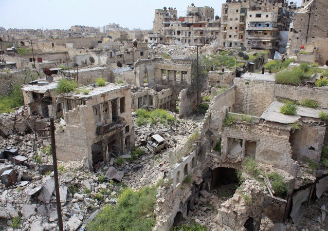 A general view shows destruction in the Hamidiyeh neighbourhood of the northern Syrian city of Aleppo as local popular committee fighters, who support the Syrian government forces, try to defend the traditionally Christian district on the third day of intense battles with Islamic State group jihadists on April 9, 2015