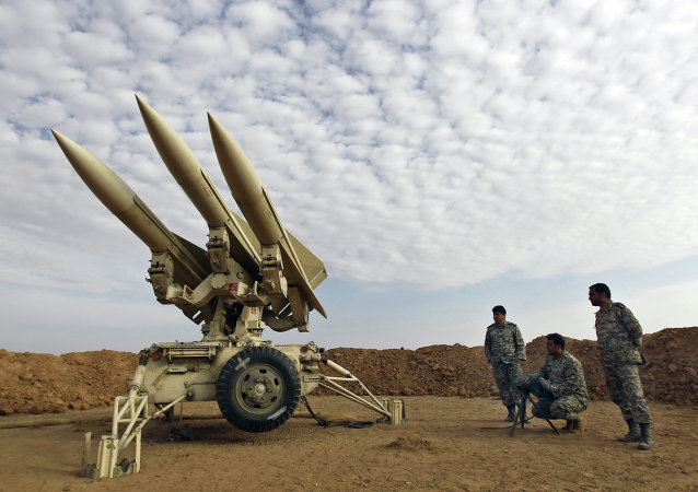 In this Nov. 13, 2012 file photo obtained from the Iranian Mehr News Agency, Iranian army members prepare missiles to be launched, during a maneuver, in an undisclosed location in Iran