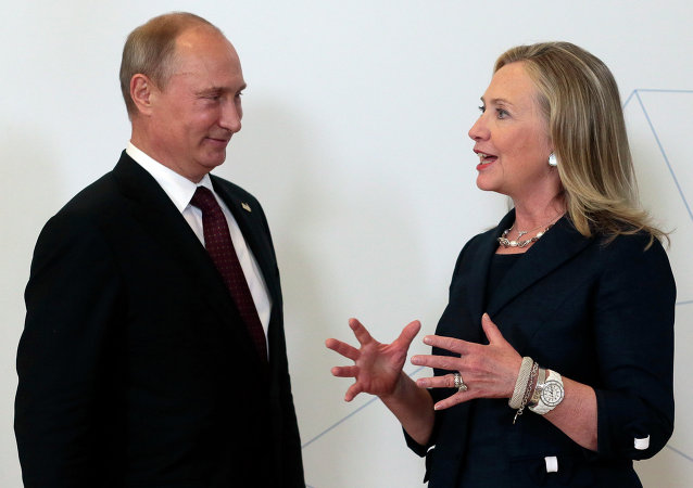 Russian President Vladimir Putin, left, meets U.S. Secretary of State Hillary Rodham Clinton on her arrival at the APEC summit in Vladivostok, Russia, Saturday, Sept. 8, 2012.
