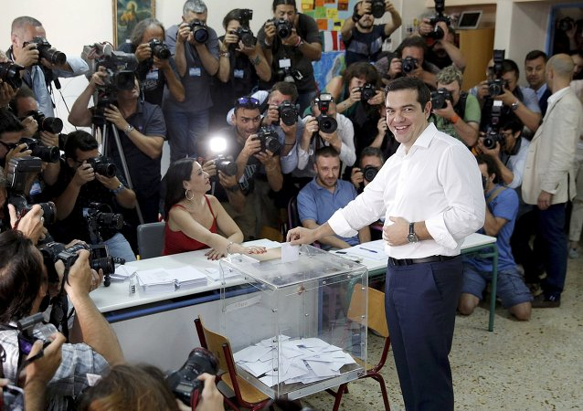 Greek Prime Minister Alexis Tsipras votes at a polling station in Athens, Greece July 5, 2015
