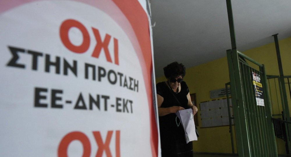 An elderly woman leaves from a polling station as the poster reading ''No to the proposal of EU-IMF-ECB'' in the northern Greek port city of Thessaloniki, Sunday, July 5, 2015